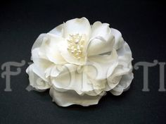 Couture Abstract-Impressionist LaLuna Magnolia bloom is great for any occasion. Wear it to embellish your dress, hat, or simply pinup in your hair. This beautiful magnolia bloom is custom hand-crafted in light ivory pearl silk charmeuse. Middle adorned with pearly stamens.