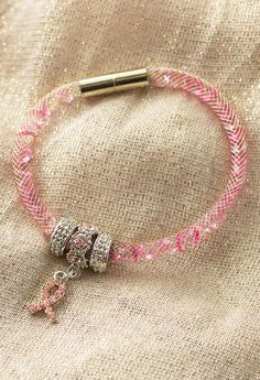 Get swept up in innovative design and sparkling beauty with our mesh-wrapped crystal bracelet that sends a glittering show of support with a dangling pink ribbon charm.