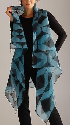 Asymmetrical Vest  Hand-dyed shibori asymmetrical vest using fiber reactive dyes on fine silk organza. Each piece begins as a whole piece of white silk. Pieced and stitched to create texture and dimension. Each piece will vary slightly. Dry clean only.  Shown in Black and Blue.    Garment Length is 46'' from shoulder to longest point, 33'' in the back of the piece.