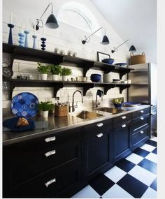 Black and white floor; black cabinet; white marble or stainless steel countertop