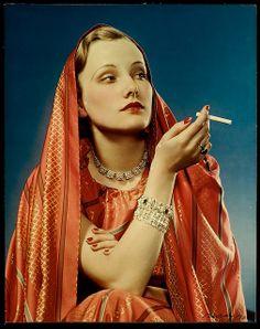 """Maker: Nickolas Muray (American 1892-1965)  Title: """"LUCKY STRIKE, GIRL IN RED""""  Date: 1936"""