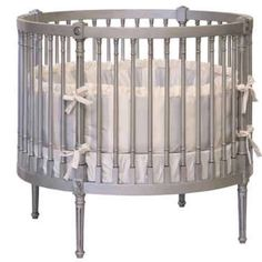 I love the idea of a circular crib. If the space is big enough to accommodate the added furniture in the middle of the room. Also may be hard to find proper bedding.