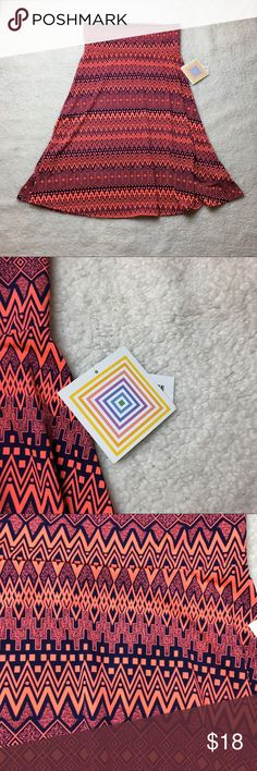 NWT Lularoe azure navy blue pink This is a navy blue and pink chevron patterned striped style Lularoe azure. Very comfortable and it's made of the slinky type material. New with the tags size medium. I ❤️ offers! LuLaRoe Skirts