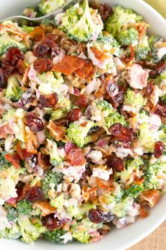 This Broccoli Salad is made with bits of salty bacon, tangy red onion, sweet craisins and crunchy sunflower seeds. Perfect for potlucks and so delicious! via salad Broccoli Salad Best Broccoli Salad Recipe, Broccoli Salad Bacon, Easy Salad Recipes, Potluck Recipes, Healthy Recipes, Cooking Recipes, Bacon Salad, Broccoli Raisin Salad, Broccoli Slaw Recipes