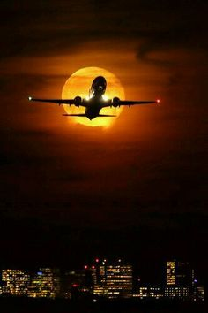 Awesome photo focusing on the plane with the image of the moon orange in appearance in the night sky and the lit up city skyline in the backround Cool Photos, Beautiful Pictures, Shoot The Moon, Sun Moon Stars, Moon Pictures, Beautiful Moon, Jolie Photo, Night Skies, Scenery