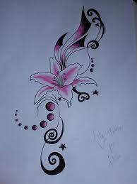lily tattoo.. swirly :/ thigh?