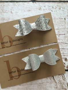 Silver Glitter Hairbow on Alligator Clip [select: regular glitter or large fleck] by letterbdesigns on Etsy https://www.etsy.com/listing/265196895/silver-glitter-hairbow-on-alligator-clip