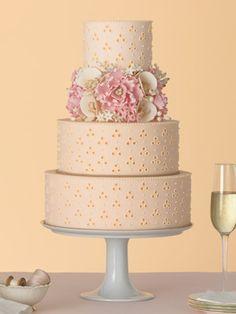 Peach eyelet fabric wedding cake