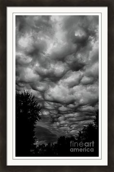 Grey Framed Print featuring the photograph Clouds Rolling In by Stephanie Forrer-Harbridge
