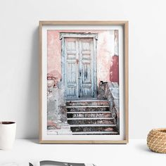 This is rustic door art print is gorgeous printable boho wall decoration for your home. A rustic blue door against a blush wall, this bohemian large art photograph was taken in Greece; it makes a perfect gift for anyone who loves the look of the Mediterranean. The rustic look of this