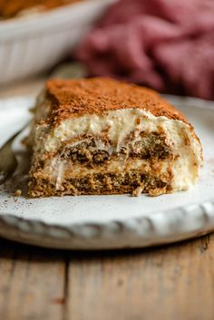 The easiest and most delicious Tiramisu recipe! This authentic Italian dessert is rich and creamy but as light as air made with coffee dunked Savoiardi (ladyfingers), a smooth and creamy mascarpone filling and dusted with cacao powder to finish it off. Perfect for any occasion! Authentic Tiramisu Recipe, Best Tiramisu Recipe, Authentic Italian Desserts, Italian Recipes, Just Desserts, Delicious Desserts, Dessert Recipes, Yummy Food, Drink Recipes