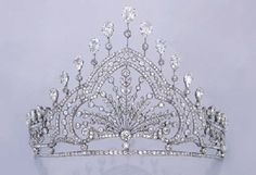 A BELLE EPOQUE DIAMOND TIARA  The front designed as a spray of old European-cut and collet diamond leaves, within alternating diamond-set and collet-set arched and scrolled frames, the sides decorated with a band of leaves, set upon collet intersections and line border, the top set with a series of pear-shaped diamonds, with collet and knife-edged detail, circa 1910