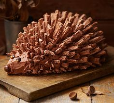 Hedgehog cake. A celebration cake with a touch of woodland style, this chocolate cake is decorated with edible spikes, buttercream and chocolate details.