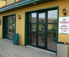 glass garage doors with pedestrian walk through door JPR Inc.