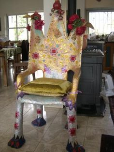 Cover a plastic chair with papier mache