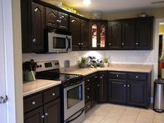 Refinished our old OAK cabinets with espresso finish, added white subway tile backsplash.