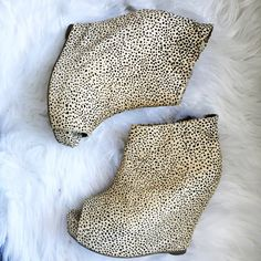 Open Toed Spotted Wedges  These shoes are SO cool. These open-toed, wedges have a calf-hair exterior with leopard-like spots. They're super easy to walk in and make a gorgeous statement piece to any outfit! Jeffrey Campbell Shoes