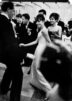 """""""Audrey had a coiffured fringe on her face instead on her skirt, where orthodox twisters should have it, but there was nothing wrong with her technique. It delighted her husband, Mel Ferrer, at a charity ball aboard the new liner France in Le Havre. The ship didn't move but it didn't have to. Miss Hepburn had learned the twist in Paris."""