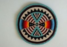 Native American Beaded Medallion.  The design is so crisp and the colors wonderful.  Sold for 127.50