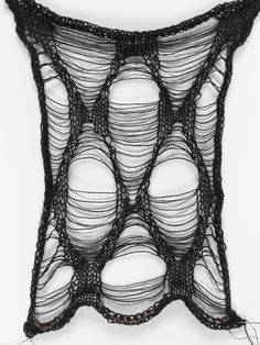 Juliana Sissons - Victoria and Albert Museum/Black knitted sample with shaped ladder technique Cotton