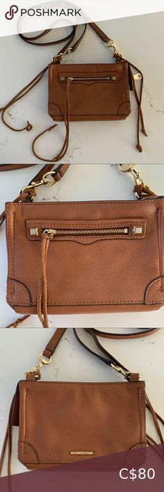 Rebecca Minkoff Regan cross body purse. The perfect purse! This bag is perfect for your phone + the essentials & goes with any outfit. The Rebecca Minkoff bag creatures an almond colour with gold hardware, adjustable/removable strap & front zipper pocket. Bag is in excellent condition, with only a few marks on the gold hardware. Rebecca Minkoff Bags Crossbody Bags Crossbody Shoulder Bag, Crossbody Bags, Rebecca Minkoff Regan Satchel, Grey Purses, Nylon Bag, Bag Sale, Gold Hardware, Leather Purses, Cross Body