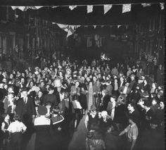 Revelers pack Lambeth Walk, London, to celebrate VE Day, the end of WW2 in Europe