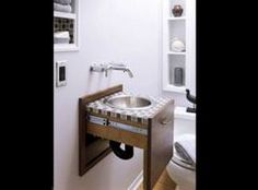 Idea for a small bathroom.... sink in a drawer!