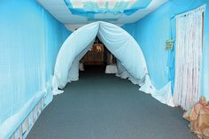 This ice hall was created with fabric and snow embellishments. There's even a replica later on the left just like they use to cross the crevasses in the Khumbu Icefall on Everest. Learn more about Everest VBS by visiting http://www.group.com/everest. #EverestVBSDecorating #EverestVBS2015