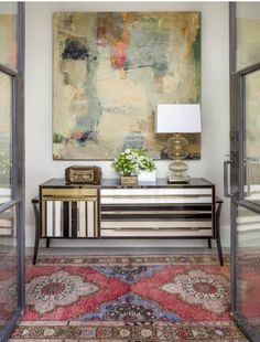 Entry with chic cabinet & eye catching rug