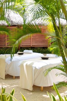 Relax with a massage in an open-air treatment room at the spa. LUX* Grand Gaube (Mauritius) - Jetsetter