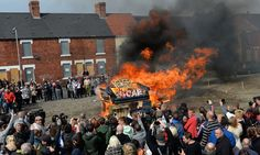 An effigy of Margaret Thatcher in a 'coffin' is burnt together with a sofa as people gather to celebrate her death  in Goldthorpe, northern England.