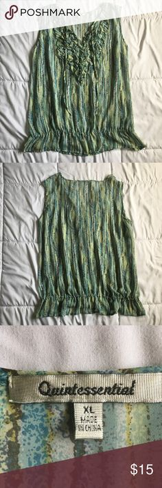 Quintessential tank top Super Cute tank top, can be dressed up or down. Great for office setting. Excellent used condition. Measurements on pictures. (Approximate measurements)  Size XL  Smoke free home. Pet friendly.  #13 Quintessential Tops Tank Tops