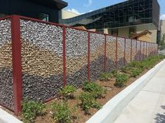 University of Chicago Child Care Center uses McNICHOLS ECO-ROCK™ Wall System to create a wire mesh fence filled with colorful rocks. We invite you to browse our inventory at http://www.mcnichols.com