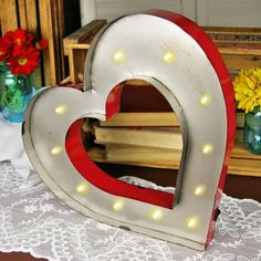 This red and silver metal heart sign measures 14 inches tall and is illuminated by 11 warm white LEDs that are battery operated. Boat Lights, String Lights, Marquee Lights, Valentines Day Hearts, Romantic Dinners, Heart Sign, Battery Operated, Event Decor, Light Up