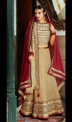 Flaunt your grace and elegance clad in this cream shade banarasi silk lehenga cholie. The lace, resham and stones work appears to be chic and perfect for any party. #StunningLehengaCholi