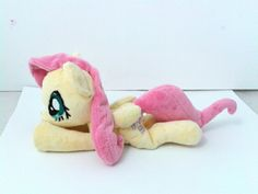 Custom mlp plushie. Fluttershy is made out of minky fabric, all purpose thread and embroidery floss. Stuffed with poly fiber and polystyrene pellets. Eyes and cutie mark are hand embroidered on felt, and then put on minky with appliqué. #mlp, #plushie, #plush, #mylittlepony, #fluttershy
