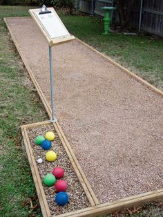 Learn how to build a backyard bocce ball court, complete with a ball holder and . Learn how to build a backyard bocce ball court, complete with a ball holder and scoreboard, for hours of entertainme Backyard Games, Backyard Projects, Outdoor Projects, Backyard Landscaping, Landscaping Ideas, Backyard Ideas, Patio Decks, Backyard Designs, Landscaping Software