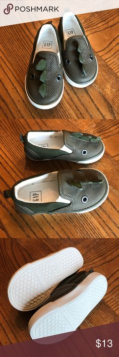 BabyGap Dinosaur slip on shoes size 6 NWOT I purchased these and removed the tags but when I went to put them on my son his foot is too wide for them unfortunately. Since I removed the tags I can't return them...lesson learned. GAP Shoes
