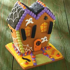 Crooked River Gingerbread House - nothing spookier than a Halloween haunted house. And there's nothing better than lots of sweet treats and candies at Halloween! This fully decorated haunted gingerbread house has both. Better eat this Halloween house up before these sweet ghosts wreak too much havoc!