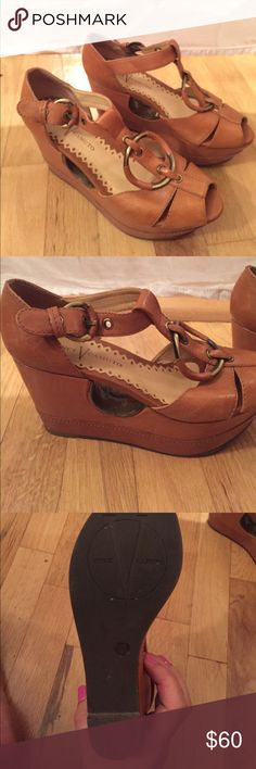 Vince Camuto wedges Vince Camuto wedges in cognac! Worn only once, they just weren't my style. They are in perfect condition, and come with the box. Please make an offer! Vince Camuto Shoes Wedges