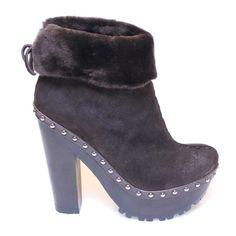 """Prada Miu Miu Platform Leather Booties Clogs 8.5 Man I love these... 100% Authentic Miu Miu  by Prada Clog Booties.  Stunning, highest quality expresso brown lamb leather with fold over fur detail/fur lining. The boots have a zip-closure and stunning decorative studs all around the shoe. Lug rubber sole and wood platform. Oh did I mention they are pretty badass?? Size EU 38.5, or 8.5  approx 2"""" platform, 6""""heel. Comes with dustbags and box. Worn once for an hour-too big on me! Miu Miu Shoes…"""