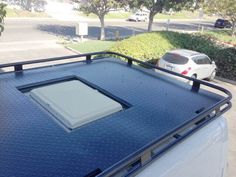 Aluminess roof rack for Dodge ProMaster.  Cut outs for vent...low-profile rack