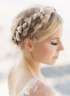 Consider milkmaid braids for your wedding hairstyle. They are sweet, innocent, and so, so pretty. See more of our wedding hairstyles here. #milkmaidbraids #braids #wedding #hair