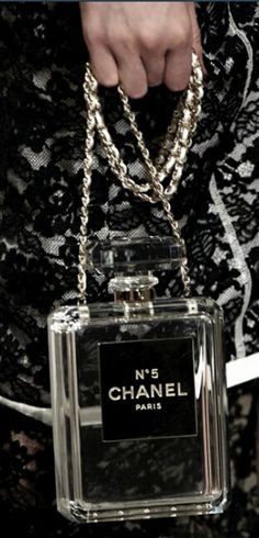 Chanel N°5 Perfume Bottle Bag Oh holy glorious Chanel perfume bag!!! Do you have to cost so much??? I am dying to hold you in my hands. Here people, if I have to choose the lust item of spring 2014!! This is it :)