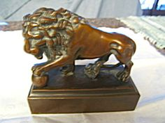 Vintage Lion bookend titled: Big Cat's Play, c: 1930. For sale at More Than McCoy at http://www.morethanmccoy.com