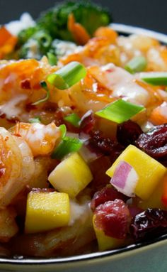 This Sweet Fire Shrimp Bowl boasts loads of tender crisp veggies, a sweet mango cranberry salsa, shrimp tossed in a spicy chili garlic sauce, and drizzled with a cooling sweet chili yogurt all over a bed of rice.