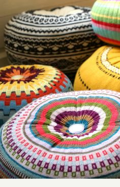 Hope & Elvis. Made of upcycled jumpers, these pouffes are wonderful! Available on etsy.    http://www.etsy.com/listing/82829999/medium-upcycled-eco-knit-fairisle-floor#zoom