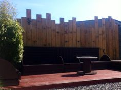 Seating area made from pallets. The wood behind the area is old flooring from a garage we tore down.