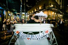 Post second line carriage exit with an adorable Happily Ever After sign! Brittney & Ty Tied the Knot! Tying the Knot Wedding Coordination, Mark Eric Photography, Nola Flora, Luminous Events, BrideFilm, The Chicory Venue, featured on Brides.com. See the full wedding here: www.tyingtheknotweddingcoordination.com/blog/brittney-ty-tied-the-knot/ #neworleanswedding #weddingcarriage #weddinggetaway