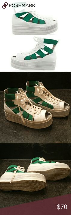 Fessura double star platform sneaker Very comfortable. European size 37 (tag says us 5 but I wear 7.5 and it fits me with no extra room at toe) these would be too big for a US sz 5 but would likely fit sz 7 better. Fessura Shoes Platforms